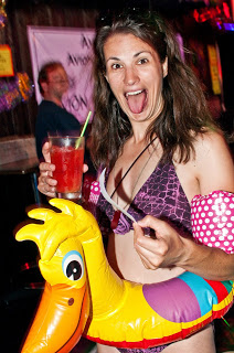 A picture of me in a bikini wearing a duck innertube, making a face at the camera.